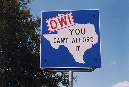 "Warning road sign for DWI in Texas ""DWI- You Can't Afford It"""